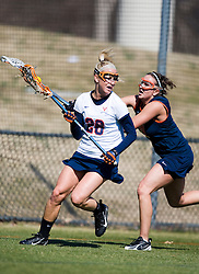Syrcause Orange D Christina Gibson (14) checks the stick of Virginia Cavaliers A Megan O'Malley (28).  The #2 ranked Virginia Cavaliers women's lacrosse team defeated the #4 ranked Syracuse Orange 13-8 at the University of Virginia's Klockner Stadium in Charlottesville, VA on March 1, 2008.