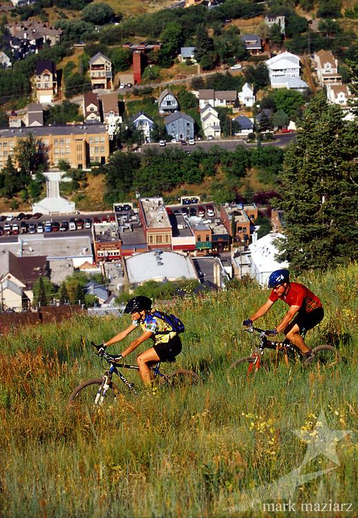 Tyler & Jenna riding above Old Town Park City