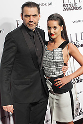 © Licensed to London News Pictures. 18/02/2014. London, UK. Roland Mouret and  Roxie Nafousi attend the ELLE Style Awards 2014 at One Embankment in central London. Photo credit : Andrea Baldo/LNP