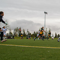 Ally Williamson, Goalkeeper (35) of the Trinity Western Spartans keeps her eye on 5th year midfielder Karlee Vorrieter (11) of the Regina Cougars during the Women's Soccer home game on September 11 at U of R Field. Credit: Arthur Ward/Arthur Images