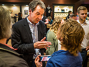 28 MAY 2019 - AMES, IOWA: Governor STEVE BULLOCK (D-MT) talks to individual voters during a campaign stop in a coffee shop in Ames. Gov. Bullock is in a crowded field of Democrats vying to be the party's Presidential nominee in 2020. Iowa traditionally hosts the the first election event of the presidential election cycle. The Iowa Caucuses will be on Feb. 3, 2020.              PHOTO BY JACK KURTZ