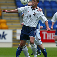 St Johnstone v Ross County....17.04.04<br />David Hannah gets the hands on treatment from Mark Reilly<br /><br />Picture by Graeme Hart.<br />Copyright Perthshire Picture Agency<br />Tel: 01738 623350  Mobile: 07990 594431