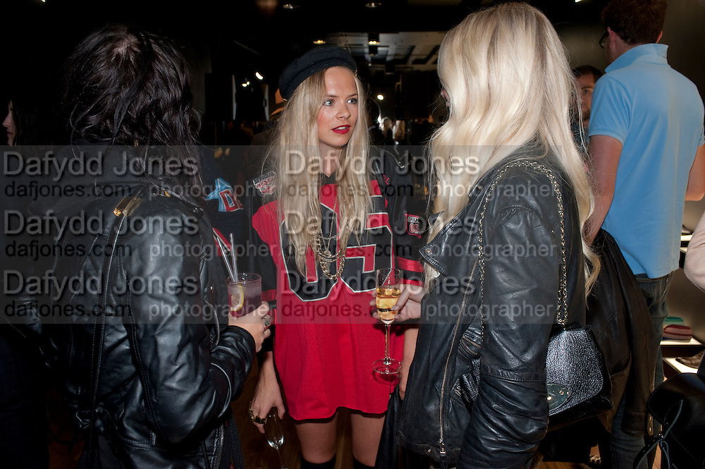 SARAH LANE; JESSICA HORWELL; CLARA PAGET United Nude launched their London shop.  in association with TANK Magazine. Floral st. Covent Garden. London. 7 September 2011. <br /> <br />  , -DO NOT ARCHIVE-© Copyright Photograph by Dafydd Jones. 248 Clapham Rd. London SW9 0PZ. Tel 0207 820 0771. www.dafjones.com.