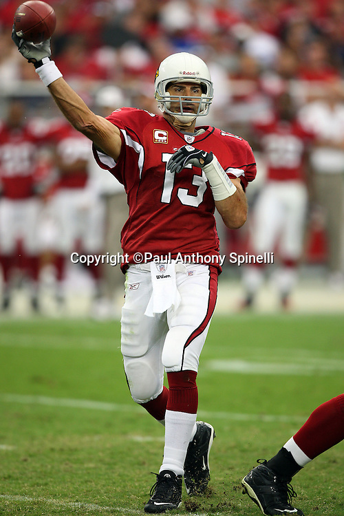 GLENDALE, AZ - OCTOBER 12: Quarterback Kurt Warner #13 of the Arizona Cardinals throws a pass during the game against the Dallas Cowboys at University of Phoenix Stadium on October 12, 2008 in Glendale, Arizona. The Cardinals defeated the Cowboys 30-24. ©Paul Anthony Spinelli *** Local Caption *** Kurt Warner
