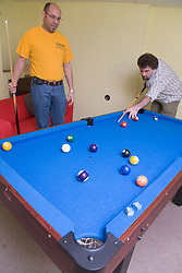 Residents of Igloo; an independent backpackers hostel in Nottingham; playing pool in the games room,
