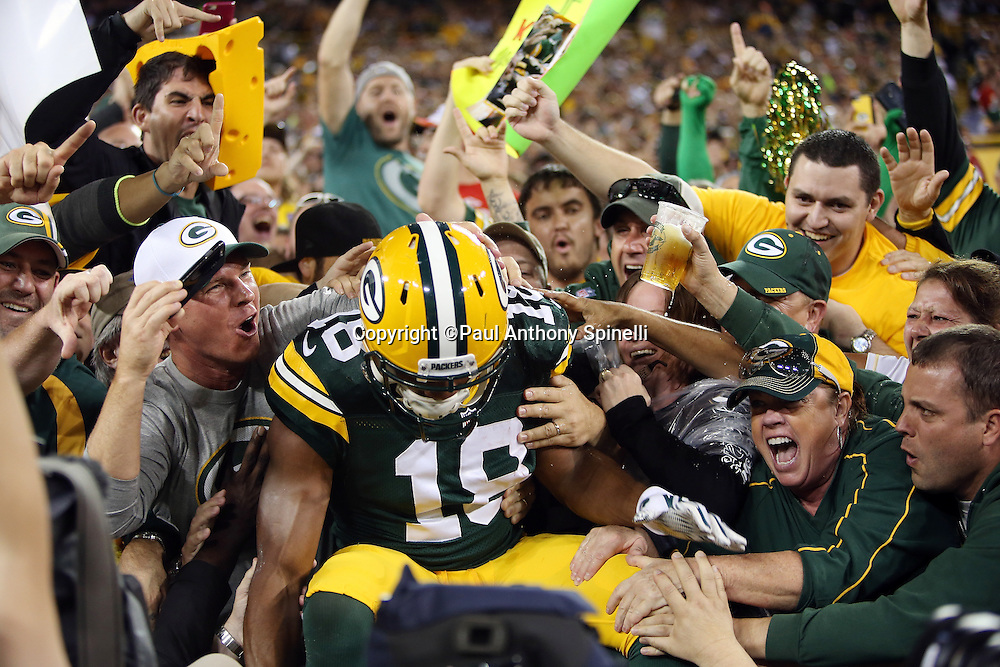 Green Bay Packers wide receiver Randall Cobb (18) does a Lambeau leap as he celebrates with fans after catching a 3 yard touchdown pass for a 14-0 first quarter Packers lead during the 2015 NFL week 3 regular season football game against the Kansas City Chiefs on Monday, Sept. 28, 2015 in Green Bay, Wis. The Packers won the game 38-28. (©Paul Anthony Spinelli)