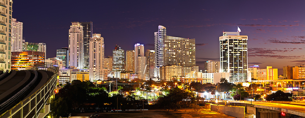 Panoramic twilight view of Miami's downtown and Brickell area just south of the Miami River, showing highrise condominium, office and rental apartment buildings WATERMARKS WILL NOT APPEAR ON PRINTS OR LICENSED IMAGES.