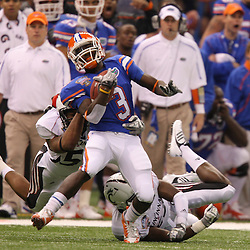 Jan 01, 2010; New Orleans, LA, USA; Florida Gators running back Chris Rainey (3) runs as Cincinnati Bearcats linebacker Andre Revels (left) and cornerback Brad Jones (right) converge on the tackle during the first half of the 2010 Sugar Bowl at the Louisiana Superdome.  Mandatory Credit: Derick E. Hingle-US PRESSWIRE.
