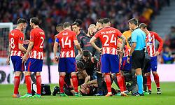 Arsenal's Laurent Koscielny receives medical attention during the UEFA Europa League, Semi Final, Second Leg at Wanda Metropolitano, Madrid.