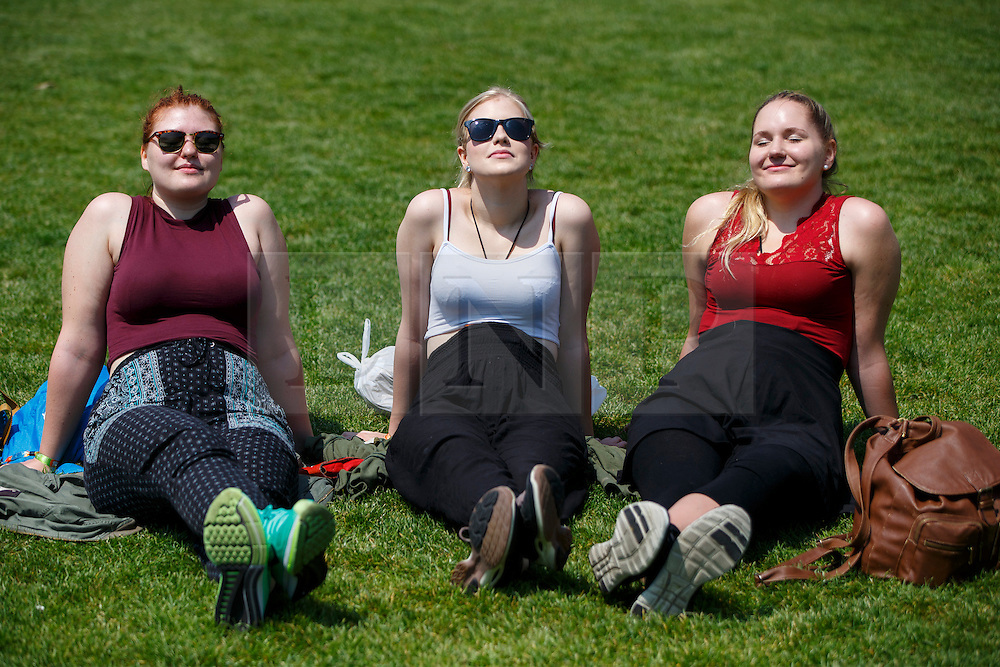 © Licensed to London News Pictures. 09/06/2016. London, UK. Anna Lahtinen, Hilda Lehtola and Mari Immonen enjoying sunshine and warm weather at lunchtime in Green Park, London on Thursday, 9 June 2016. Photo credit: Tolga Akmen/LNP