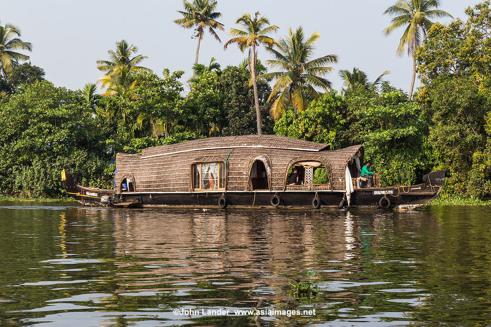 "The main mode of transportation in Kerala Backwaters has always been by kettuvallom which means ""roof boat"". They are usually made with wood joined  together with coconut ropes and painted with cashew oil outside. Many kettuvalloms have been converted to houseboats with  beds, kitchens and toilets."