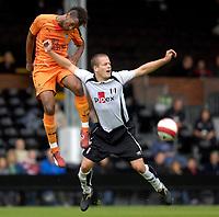 Photo: Daniel Hambury.<br />Fulham v Boavista. Pre Season Friendly. 12/08/2006.<br />Boavista's Helder Rosario and Fulham's Helder Helguson battle.
