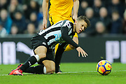 Dwight Gayle (#9) of Newcastle United attempts to regain  control of the ball as he slips during the Premier League match between Newcastle United and Brighton and Hove Albion at St. James's Park, Newcastle, England on 30 December 2017. Photo by Craig Doyle.