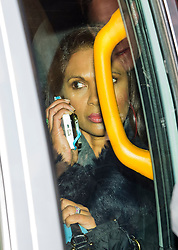© Licensed to London News Pictures. 05/12/2016. London, UK. Investment manager GINA MILLER is seen on her movie phone while being driven from the Supreme Court  in Westminster, London at the end of the first day of a Supreme Court hearing to appeal against a November 3 High Court ruling that Article 50 cannot be triggered without a vote in Parliament. Photo credit: Ben Cawthra/LNP