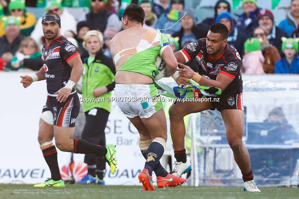 Jordan Rapana of the Raiders looses his jersey while on the attack. Canberra Raiders v Vodafone New Zealand Warriors. NRL Rugby League, GIO Stadium, Canberra Australia. 23rd July 2016. Copyright Image: Mitch Cameron/www.photosport.nz