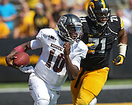 September 07 2013: Missouri State Bears quarterback Kierra Harris (10) rolls out while being chased by Iowa Hawkeyes defensive lineman Carl Davis (71) during the fourth quarter of the NCAA football game between the Missouri State Bears and the Iowa Hawkeyes at Kinnick Stadium in Iowa City, Iowa on September 7, 2013. Iowa defeated Missouri State 28-14.