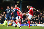 Charlton Athletic striker Josh Magennis (9) clears from Southend United striker Simon Cox (10) during the EFL Sky Bet League 1 match between Southend United and Charlton Athletic at Roots Hall, Southend, England on 31 December 2016. Photo by Jon Bromley.