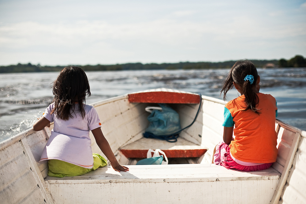 Girls in the boat at Rio Negro (Black River), around Sao Gabriel da Cachoeira town. Amazonas State, Brazil.