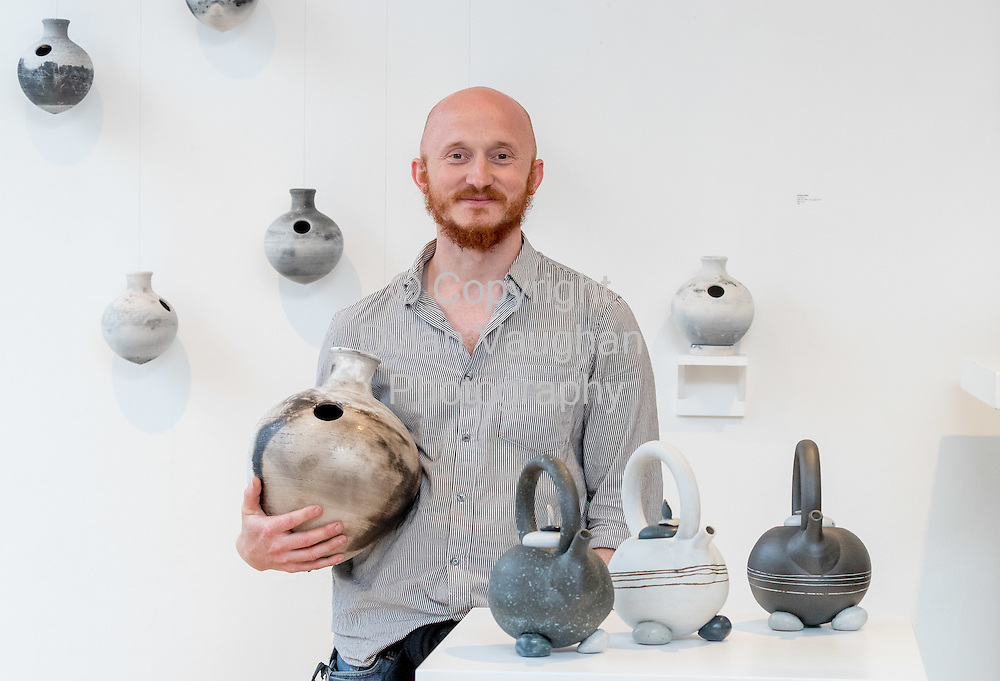 Repro Free No Charge for use<br /> <br /> 15-7-16<br /> <br /> Graduate Andrew Ilsley pictured at the opening of Cr&eacute;, an exhibition of work by the 2016 graduates of the Design &amp; Crafts Council of Ireland&rsquo;s Ceramics Skills &amp; Design Course. <br /> <br /> The exhibition was officially opened by Dr. Audrey Whitty, Keeper of the Art and Industrial Division, National Museum of Ireland &ndash; Decorative Arts &amp; History. <br /> <br /> Cr&eacute; is open at the National Craft <br /> Gallery, Kilkenny until 1st August 2016.<br /> <br /> Picture Dylan Vaughan