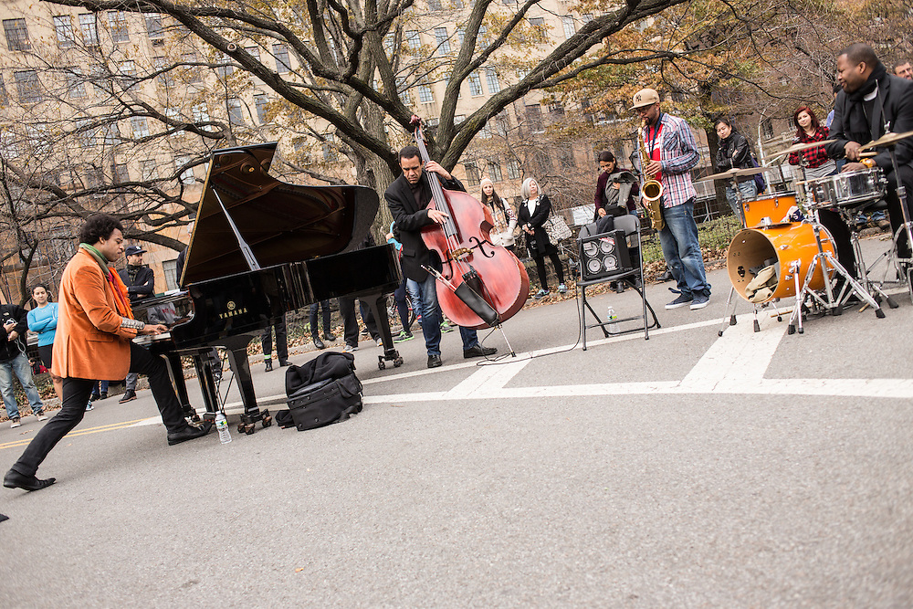 ELEW, Eric Lewis, in the orange jacket, and his combo play for the crowd at the Jazz and Colors festival in Central Park.