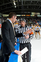KELOWNA, CANADA - DECEMBER 3: David Anning, head coach of the Brandon Wheat Kings stands at the boards and speaks to referee Jeff Ingram against the Kelowna Rockets on December 3, 2016 at Prospera Place in Kelowna, British Columbia, Canada.  (Photo by Marissa Baecker/Shoot the Breeze)  *** Local Caption ***