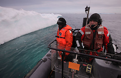 USA ALASKA CHUKCHI SEA 26JUL12 - Greenpeace crew members survey the pack ice egde at 71º20' North and 163º34' West in the Chukchi Sea near a proposed Shell drill site north of Point Hope, Alaska...The Greenpeace ship Esperanza is on an Arctic expedition to study unexplored ocean habitats threatened by offshore oil drilling, as well as industrial fishing fleets......Photo by Jiri Rezac / Greenpeace....© Jiri Rezac / Greenpeace