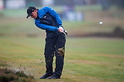 Eddie Pepperell of England hits out of the rough during the British Masters 2018 at Walton Heath Golf Course, Walton On the Hill, Surrey on 14 October 2018. Picture by Martin Cole.