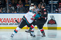 KELOWNA, CANADA - MARCH 14: Gordie Ballhorn #4 of the Kelowna Rockets checks Josh Curtis #10 of the Prince George Cougars  on March 14, 2018 at Prospera Place in Kelowna, British Columbia, Canada.  (Photo by Marissa Baecker/Shoot the Breeze)  *** Local Caption ***