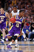 ST. LOUIS, MO - MARCH 26: Kwadzo Ahelegbe #11 of the Northern Iowa Panthers leads a fast break against the Michigan State Spartans during the Midwest regional semi-final of the NCAA men's basketball tournament at the Edward Jones Dome on March 26, 2010 in St. Louis, Missouri. Michigan State advanced with a 59-52 win. (Photo by Joe Robbins)