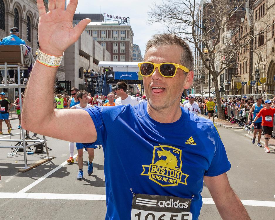 2014 Boston Marathon: happy finisher in recovery zone