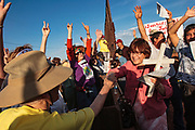 17 APRIL 2005 - NACO, AZ: Christians on the US side of the US/Mexico border (LEFT) and Mexican side of the border (RIGHT) join hands during a demonstration in support of migrants' rights. The Christians had gathered to protest the presence of the  Minuteman Project in Naco. The Minuteman volunteers were hunting migrants who crossed the border outside of Naco.      PHOTO BY JACK KURTZ
