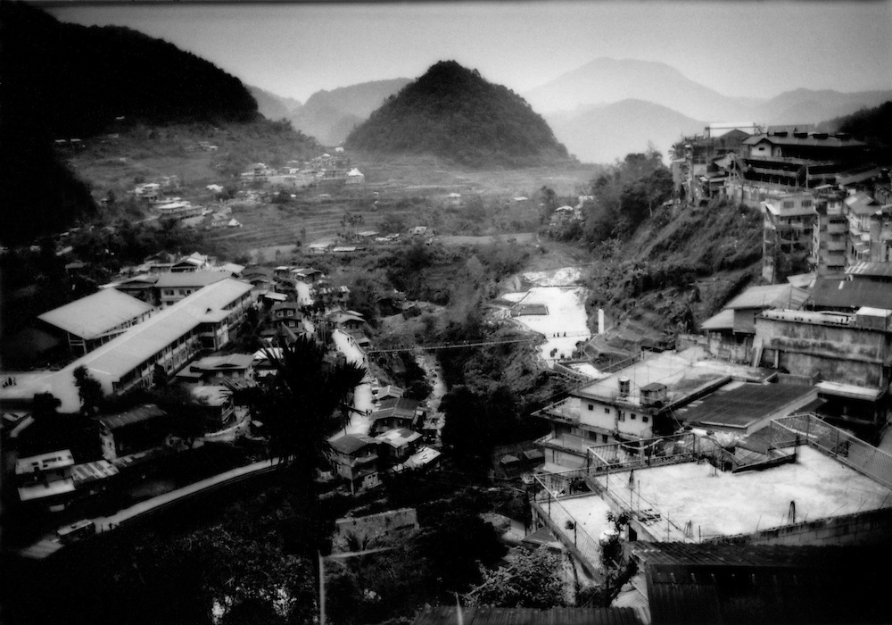 Even the Ifugao town of Banaue, seen in waning light, has seen its world famous rice fields infringed upon by development, Luzon, Philippines.
