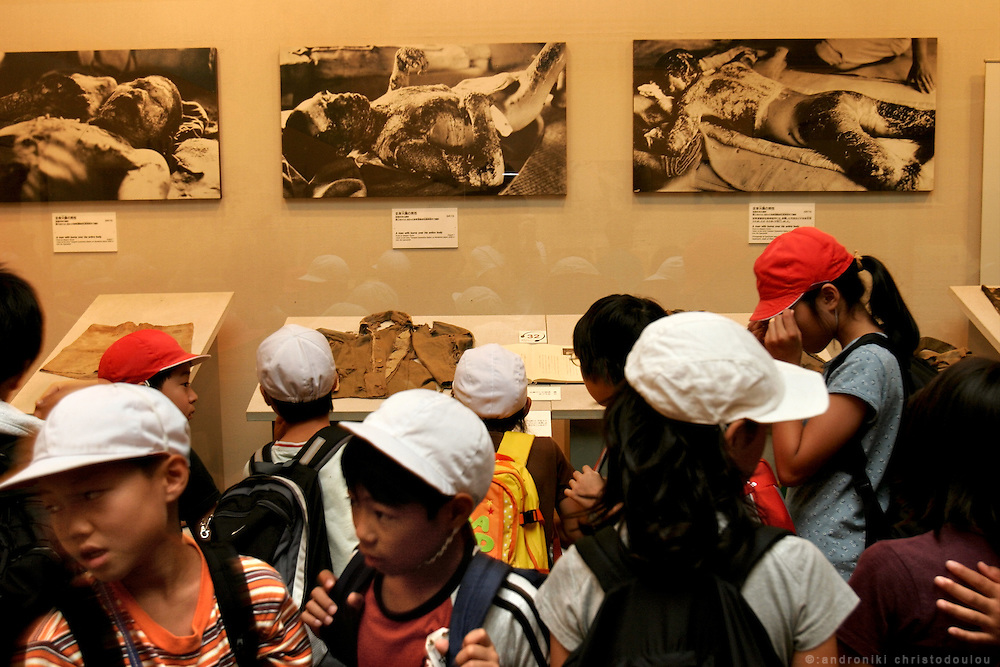 Hiroshima Peace Memorial Museum. School-children in front of pictures of people burned by the A-bomb in Hiroshima.