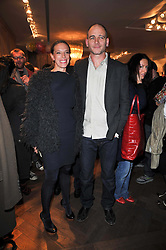 DINOS & TIPHAINE CHAPMAN at the launch party of 'Songs For Sorrow' hosted by Alber Elbaz and Mika held at Lanvin, 32 Savile Row, London on 11th November 2009.