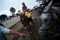 A woman rides horse back with her daughter in El Ofrio, a small remote village in the southern Colombian state of Nariño, on Saturday, June 23, 2007. There are coca fields located in the vicinity of El Ofrio, but the residents know that soon fumigation and manual eradication of their coca crops by the Colombian government will force them to find a new means to earn cash. (Photo/Scott Dalton)