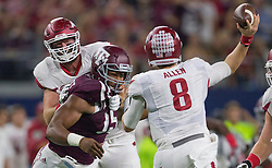 Texas A&M's defensive lineman Myles Garrett (15) gets past Arkansas' offensive lineman Dan Skipper (70) to pressure Arkansas' quarterback Austin Allen (8) during the first quarter of an NCAA college football game Saturday, Sept. 24, 2016, in Arlington, Texas. (The Eagle/Sam Craft)