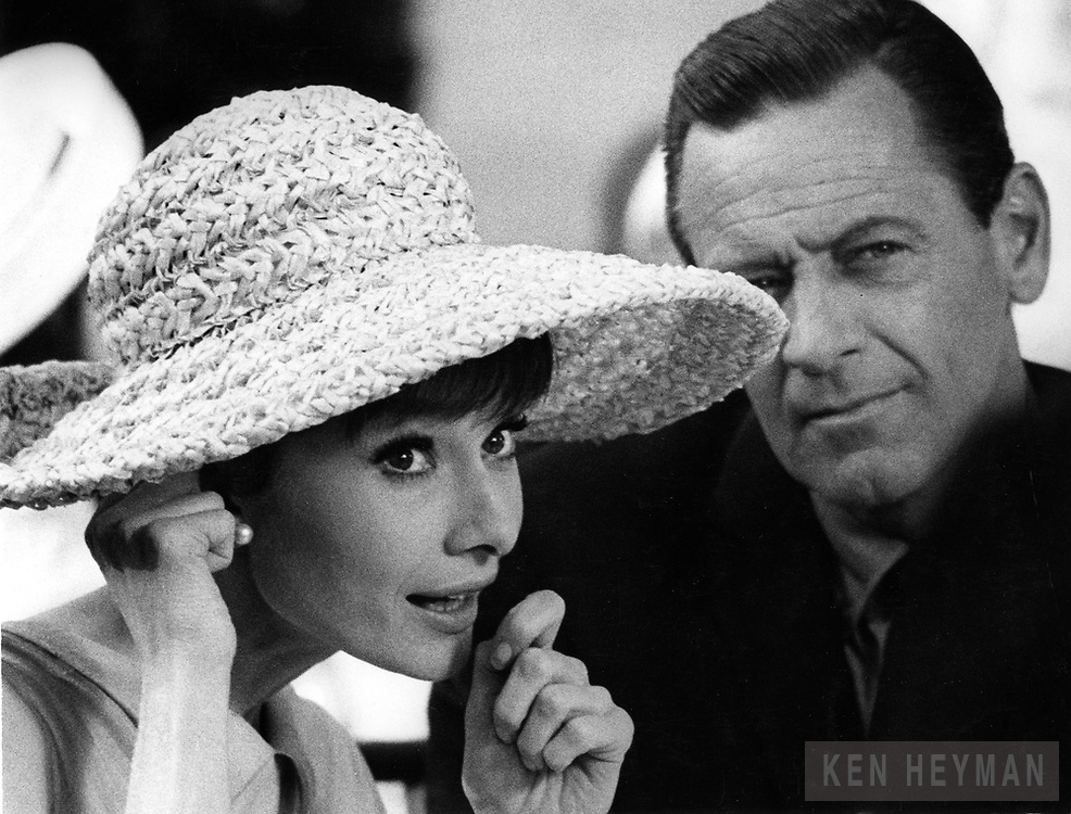 Audrey Hepburn on the movie set with Bill Holden.