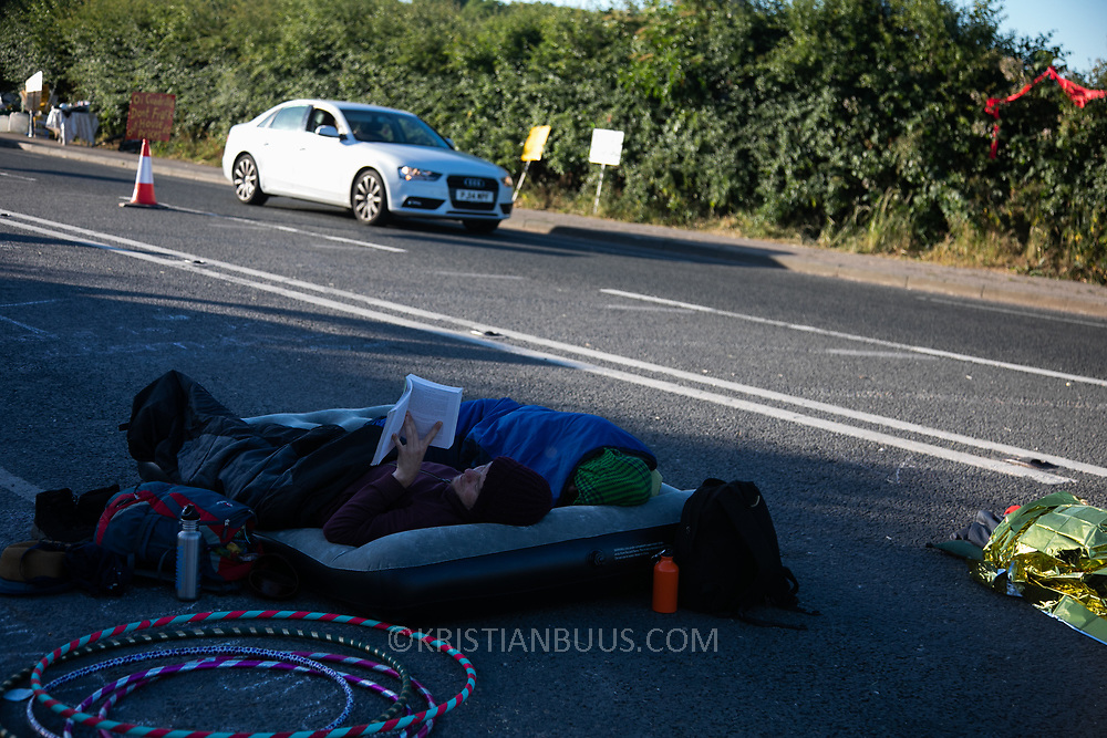 20-30 people slept on the road and are slowly waking up. Block Around the Clock - fourty eight hours of party, work shops, yoga, sleeping  and anti-fracking campaigning in front of the gates to Cuadrilla's fracking site in New Preston Road, Lancashire. The Cuadrilla site in Lancashire in a highly contested site, almost ready to extract gas. Block Around the Clock is part of a nationwide campaign to prevent fracking in Lancashire and across the England ( fracking is either banned or put on hold  in Scotland, Wales and Northern Ireland.)