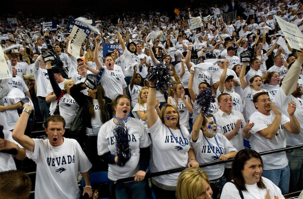 NVMBBALL_NMSU_030307..Nevada fans cheer on the Wolf Pack against New Mexico State at Lawlor Events Center in Reno, Nev., Saturday, March 3, 2007. Nevada won 69-65. Before the game, white t-shirts were placed each seat for the fans to wear. Nevada honored seniors Denis Ikovlev, Kyle Shiloh and Nick Fazekas. Fazekas and Shiloh left the court Saturday night, the win-ingest players in Wolf Pack history...Photo by David Calvert