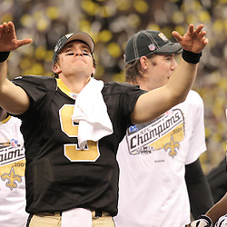 Jan 24, 2010; New Orleans, LA, USA; New Orleans Saints quarterback Drew Brees (9) celebrates an overtime victory over the Minnesota Vikings in the 2010 NFC Championship game at the Louisiana Superdome. Mandatory Credit: Derick E. Hingle-US PRESSWIRE