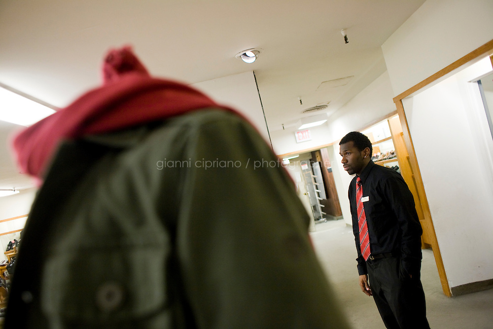 28 November, 2008. Brooklyn, New York. A shopper is here at the Macy's store at the Fulton Street Mall on Black Friday, the day that is supposed to be the busiest of the year.<br /> <br /> ©2008 Gianni Cipriano for The New York Times<br /> cell. +1 646 465 2168 (USA)<br /> cell. +1 328 567 7923 (Italy)<br /> gianni@giannicipriano.com<br /> www.giannicipriano.com