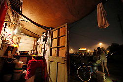 A picture made available on 30 July 2013 of a view of a kitchen of a slum or shanty town area by the second ring road of Beijing, a few hundred metres away from the prosperous Central Business District (CBD), separated only by a busy highway in China, 29 July 2013. Beijing announced plans to spend 500 billion yuan (61.5 billion euros) to renovate shanty towns within the fourth ring road according to local media. The five-year plan is expected to affect more than 230,000 households. China's massive urbanization push has resulted in the creation of large pockets of shanty towns and slums in urban areas as millions of migrant workers shifting to the cities are often priced out of city-centre properties. Slum or shanty town dwellers often live in dirty and cramped conditions, where they have no running water in their homes and have to share toilet and shower facilities.