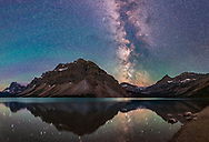 A panorama of Bow Lake in Banff National Park, Alberta on a very dark and clear night, July 17, 2018. The Milky Way toward the galactic core lies above Bow Glacier. Saturn is reflected in the still waters. <br /> <br /> Bands of green airglow colour the sky to the south at left.<br /> <br /> I shot this about 2:45 am July 17, 2018. This is a crop of a full 360&deg; panorama consisting of three tiers of 7 segments each, with the 20mm Sigma Art lens at f/2 and Nikon D750 at ISO 6400 for 30 seconds for each segment. <br /> <br /> I used the Syrp Genie Mini for the automatic camera positioning in azimuth. I stitched the panorama with PTGui.
