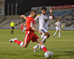 Nicosia, Cyprus - Saturday, October 13, 2007: Wales' captain Craig Bellamy in action against Cyprus' Chrisou Paraskevas during the Group D UEFA Euro 2008 Qualifying match at the New GSP Stadium in Nicosia. (Photo by David Rawcliffe/Propaganda)