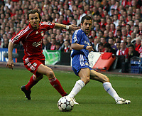 Photo: Paul Thomas.<br /> Liverpool v Chelsea. UEFA Champions League. Semi Final, 2nd Leg. 01/05/2007.<br /> <br /> Bolo Zenden (L) of Liverpool can't stop Joe Cole's pass.