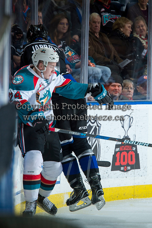 KELOWNA, CANADA - DECEMBER 30: Ralph Jarratt #4 of the Victoria Royals checks Kyle Topping #24 of the Kelowna Rockets at the boards during first period on December 30, 2017 at Prospera Place in Kelowna, British Columbia, Canada.  (Photo by Marissa Baecker/Shoot the Breeze)  *** Local Caption ***