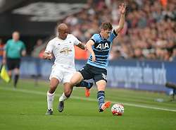 Andre Ayew of Swansea City battles for the ball with Ben Davies of Tottenham Hotspur - Mandatory byline: Alex James/JMP - 07966 386802 - 04/10/2015 - FOOTBALL - Liberty stadium - Swansea, England - Swansea City  v Tottenham hotspur - Barclays Premier League