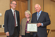 From left: Joseph Shields, Vice President for Research & Creative Activity and Dean of Ohio University's Graduate College along with Pam Benoit, Executive Vice President and Provost, congratulate Jefferey Anderson for being a finalist for the Provost's Award for Excellence in Teaching during the 2016 Faculty Awards Recognition Ceremony held at Baker Center on Tuesday, September 6, 2016.