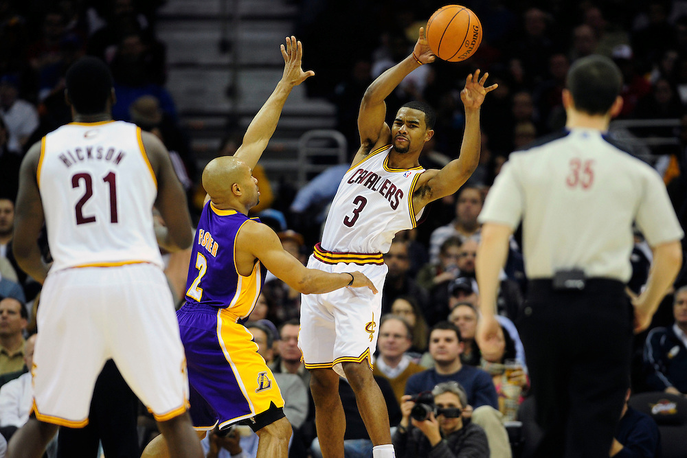 Feb. 16, 2011; Cleveland, OH, USA; Cleveland Cavaliers point guard Ramon Sessions (3) makes a pass to power forward J.J. Hickson (21) while under pressure from Los Angeles Lakers point guard Derek Fisher (2) during the third quarter at Quicken Loans Arena. The Cavaliers beat the Lakers 104-99. Mandatory Credit: Jason Miller-US PRESSWIRE
