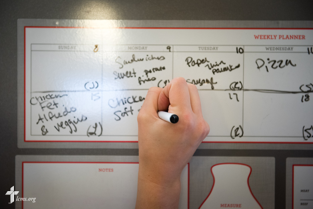 Resident Director Rachel Woolery jots a weekly meal plan at Redeeming Life Maternity Home  on Thursday, Feb. 12, 2015, in Sanford, Fla. The Christ-centered home of Redeeming Life Outreach Ministries is a safe haven for single women in crisis pregnancy. LCMS Communications/Erik M. Lunsford